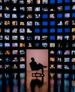 Man Surrounded by Televisions